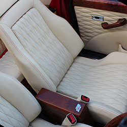 classic mini interior designls ltd custom leather upholstery cream leather quilted seat centres red stitching mohogony wood trim recaro front seats